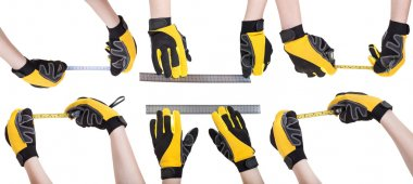 Worker hands in safety gloves with measuring tools