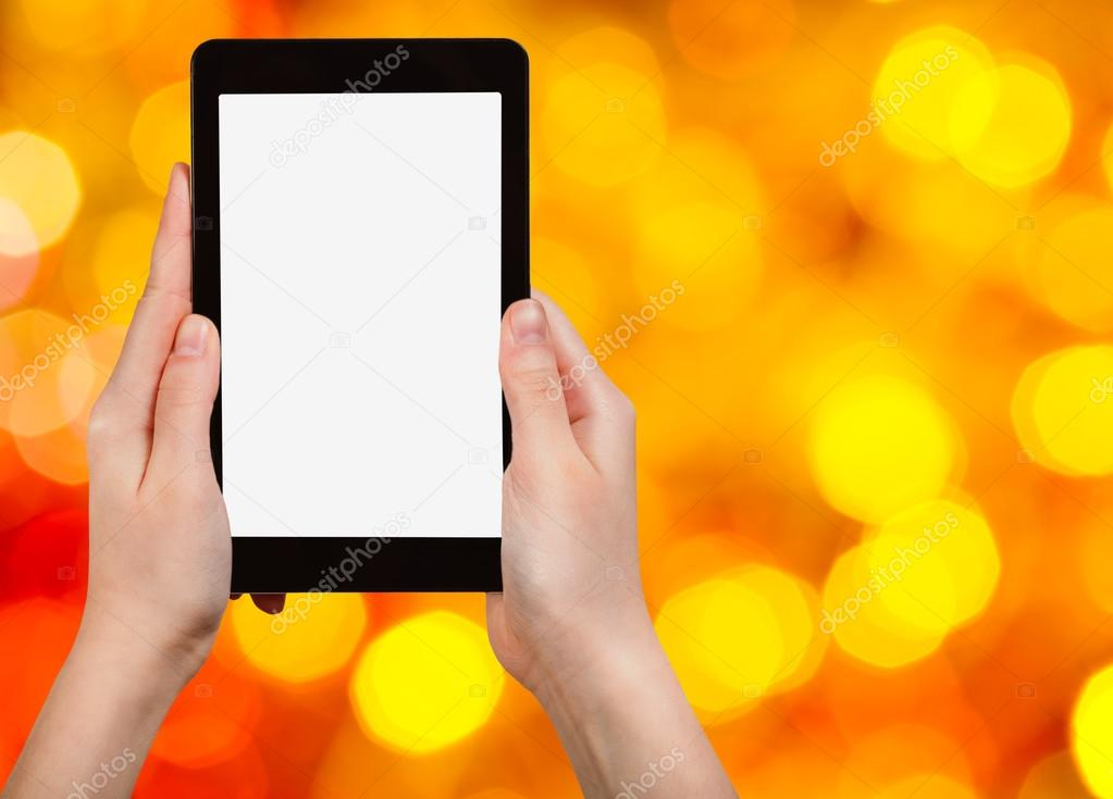 hand with tablet pc on blurred xmas background