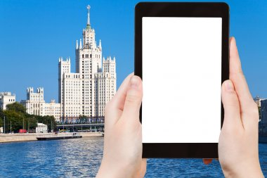 tablet with cut out screen and Moscow skyscraper