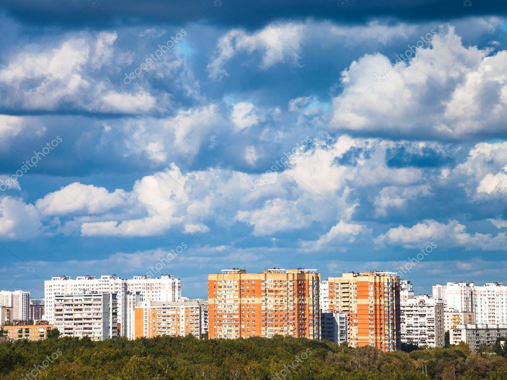 heavy low blue clouds over residential quarter