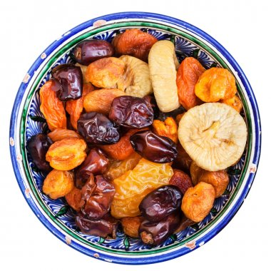 above view of dried fruits in bowl isolated