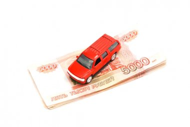 red car and Russian banknotes