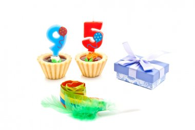 cakes with ninety five years birthday candles, whistle and gift