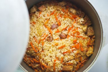 Pilaf with meat and vegetables above