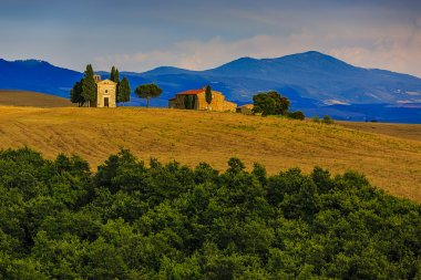 Tuscany landscape hills and meadow, Sunset over the chapel Vitaleta, San Quirico di Orcia, Tuscany, Italy stock vector