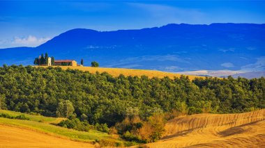 Tuscany landscape hills and meadow, Sunset over the chapel Vital