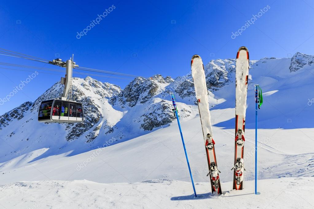 cable car and ski equipments on ski run