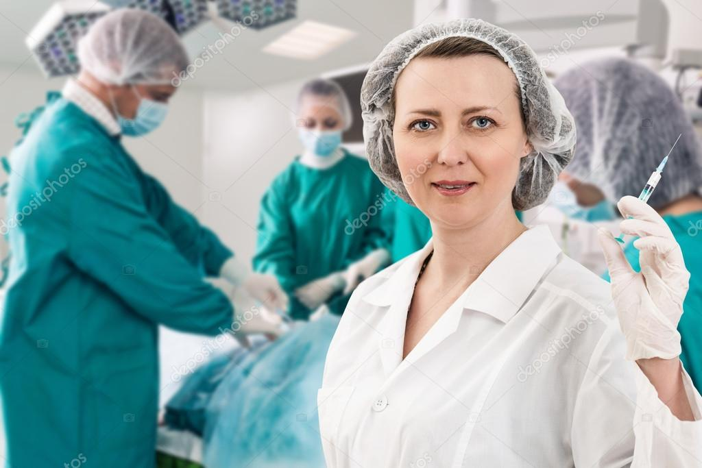 Anesthetist With Syringe And Surgery Teem Stock Photo Kotin