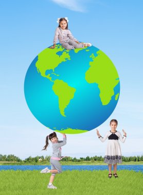 Little smiling girls with a globe