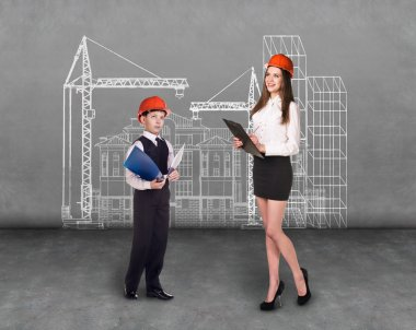 Little boy and woman builder in helmet thinking in front of plan stock vector