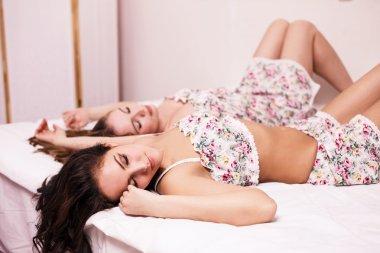 Ttwo beautiful women in the bed