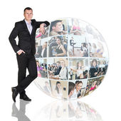 Man stands beside collage sphere