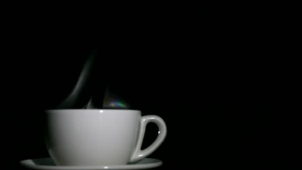 White cup of tea or coffee  with steam on  black background. 4K left side