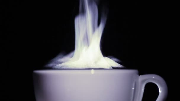 Cup of tea or coffee  with steam on  black background. close up