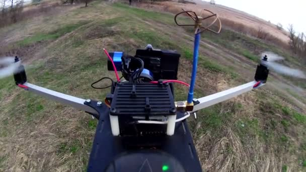 Drone, copter  flies up and films  dried tree through camera with gimbal