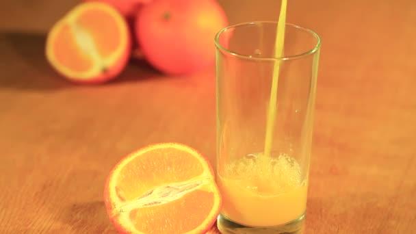 Orange juice with a fruit half