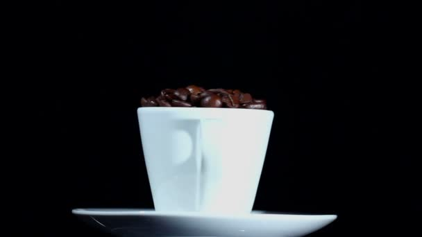 White cup with a saucer and coffee grains