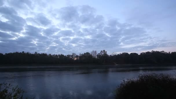 Beautiful clouds  and river in sunrise sky. Time lapse landscape
