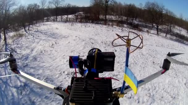 Drone with  flag of Ukraine and video camera fly. Aerial  winter