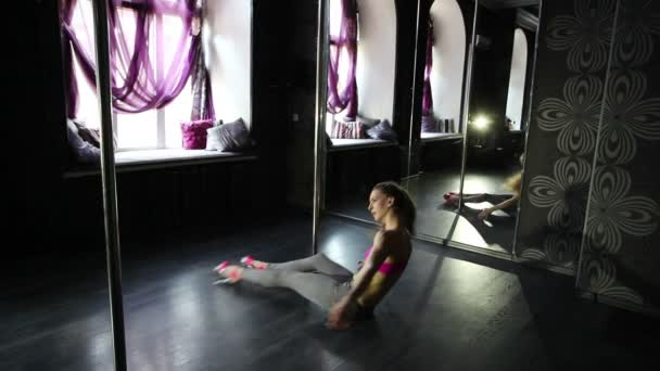 Training process of young  sexual girl dancer  in  pole hall