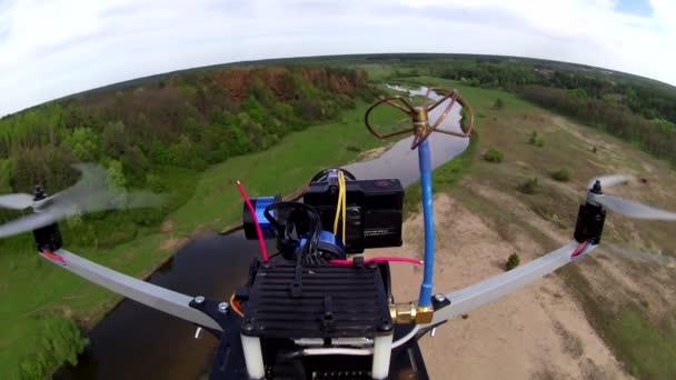 POV clip  of flighf filming drone over  river in  field