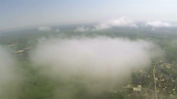 Real  plane drone flight in clouds. POV FPV clip