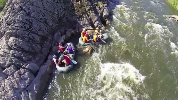 Group of people having fun on rafting  on  river. Aerial top