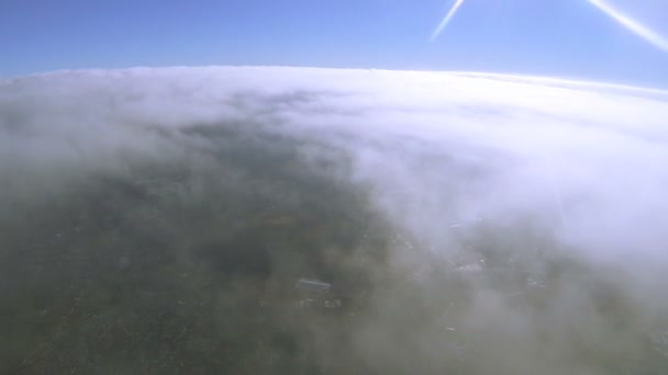 Flight   through  clouds at  height of 2000 meters. Aerial shot from radio-controlled  drone