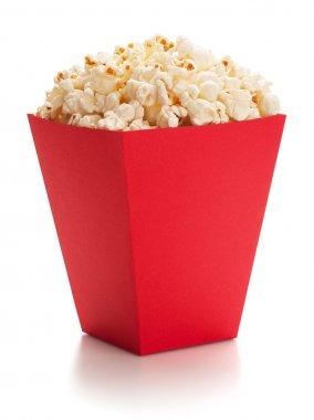 Full red bucket of popcorn.
