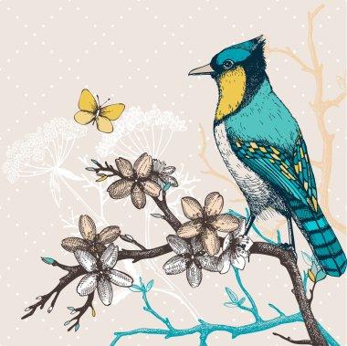 Bird on blooming tree twig