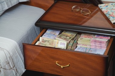 Bundles of banknotes in bedside table