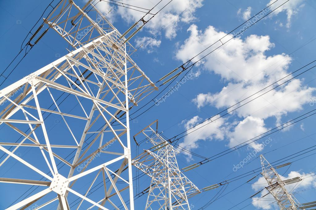 Power transmission lines against blue sky