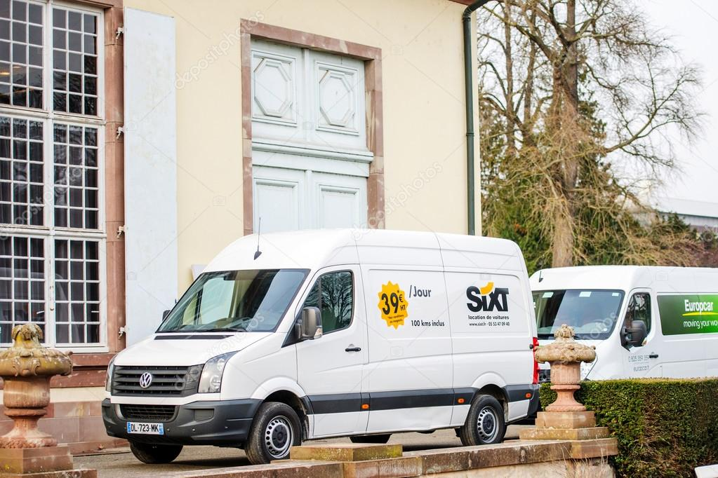 Sixt and Europcar renting vans in front of building