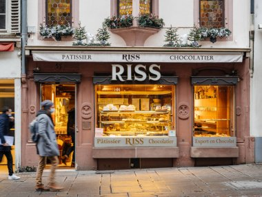 Pedestrians people walking in front of Ross Patissier Chocolatier bakery in central Strasbourg the iconic landmark of the city selling delicious pastries and bread
