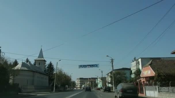 Car passing under electoral banner