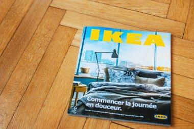 IKEA Catalog on wooden floor