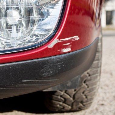 Scratch on a car bumper - right under the headlight