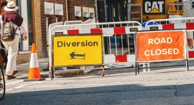 Road closed sign and diversion on London streets
