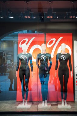 Mannequins wearing percentage discount t-shirts fall sale