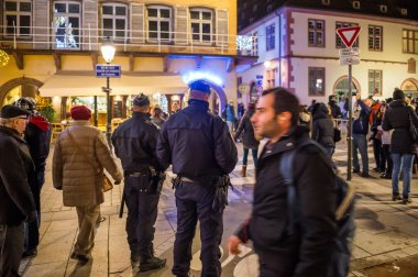 Police officers surveilling Christmas Market