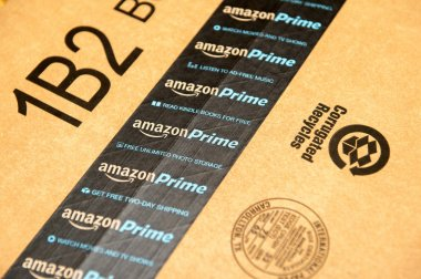 Amazon Prime logotype printed on cardboard box security scotch t