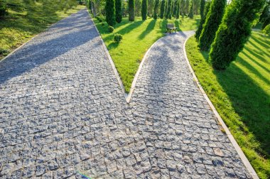 Perspective view of two cobblestone roads decision