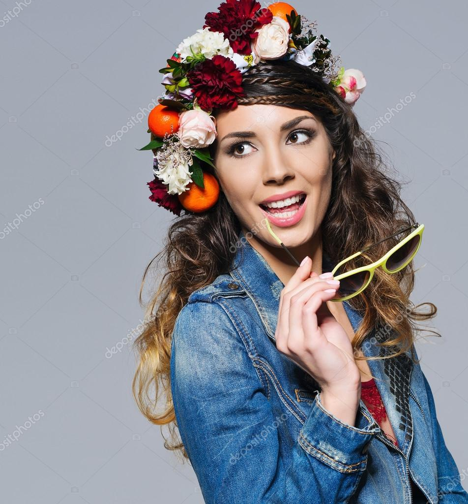 Beautiful Woman In Flower Crown Holding Sunglasses Stock Photo