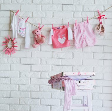 Baby clothes hanging on the wall
