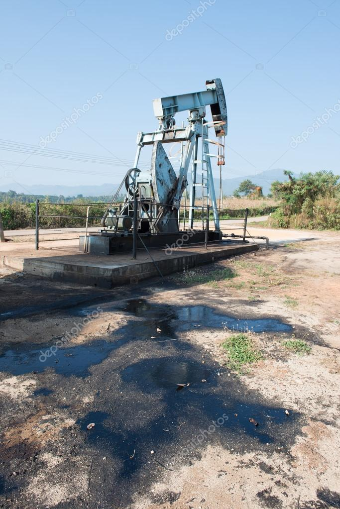 pump jack with crude oil contamination