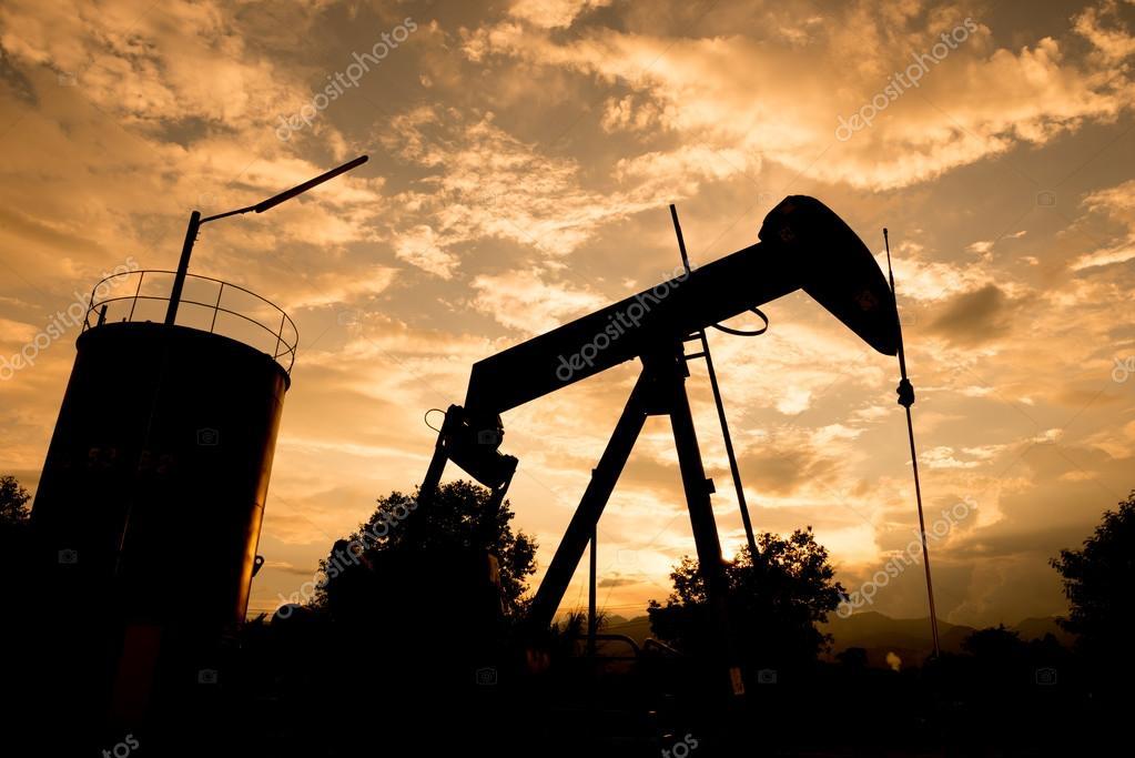 old pumpjack pumping crude oil