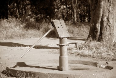 An old water pump on a street of the village Pomerini in Tanzani