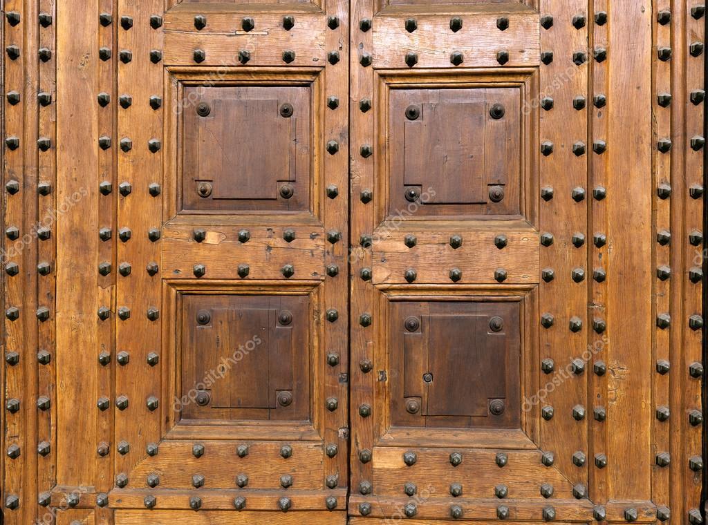 Ancient Wooden Door with Studs \u2014 Stock Photo & Ancient Wooden Door with Studs \u2014 Stock Photo © catalby #106442000