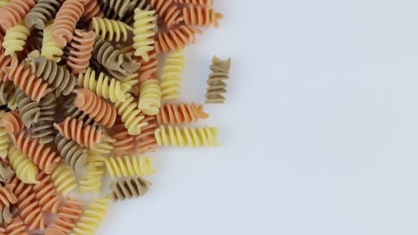 Colored spiral pasta as a background, rotate clockwise.