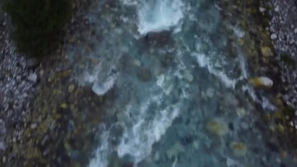 River water foaming and splashing on cliffs of Alpine Mountains in Theth, Albania
